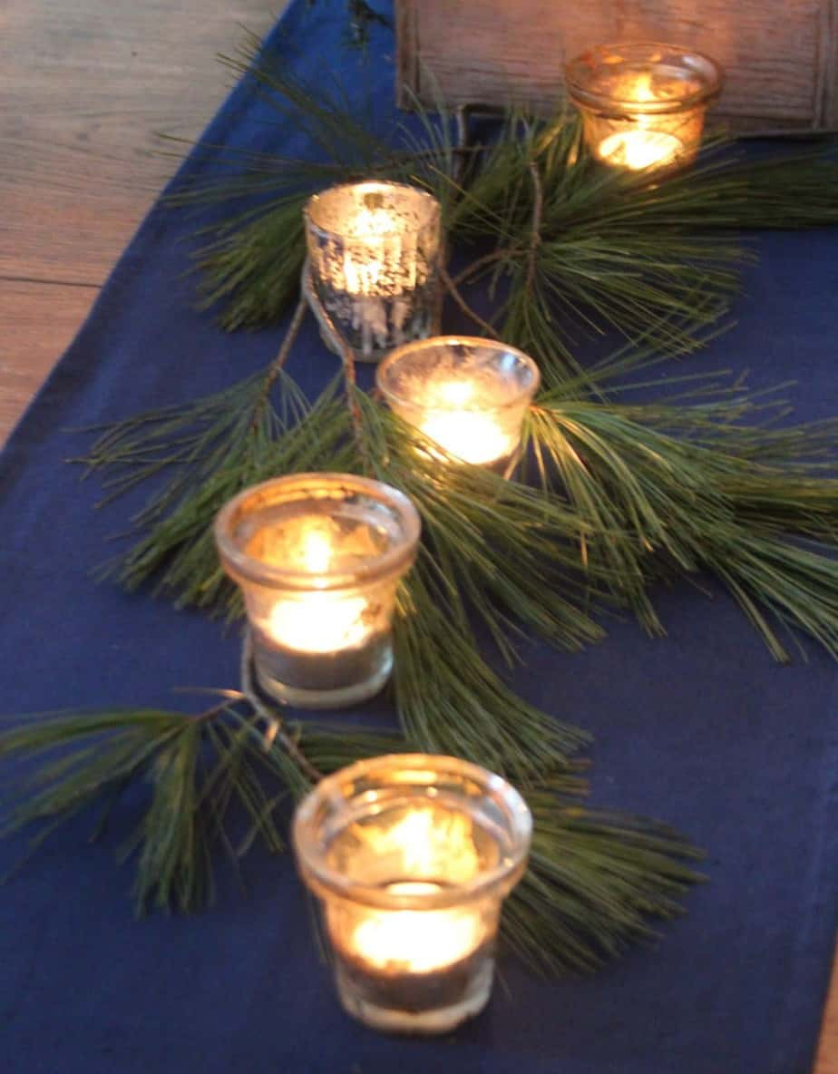 Evergreens, candles and twinkling white lights make a home magical for Christmas.