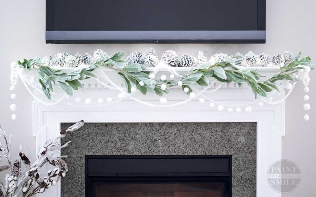 A Christmas fireplace with a TV above the mantle by Paint Yourself A Smile