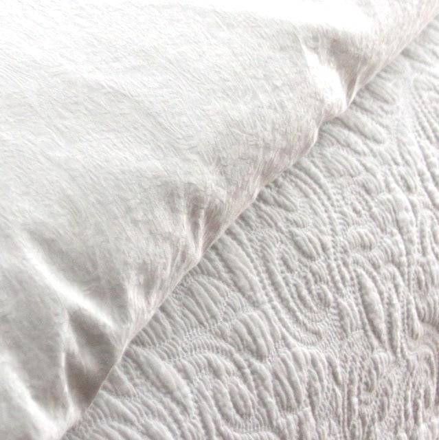 White bedding is easy to mix with other patterns and colors, can be bleached and never looks dated.
