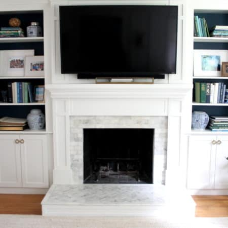 Styling fireplace bookcases with a color palette of blues, greens and white with a few natural elements.