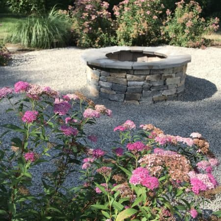 Metal garden edging keeps landscape materials from spilling over.