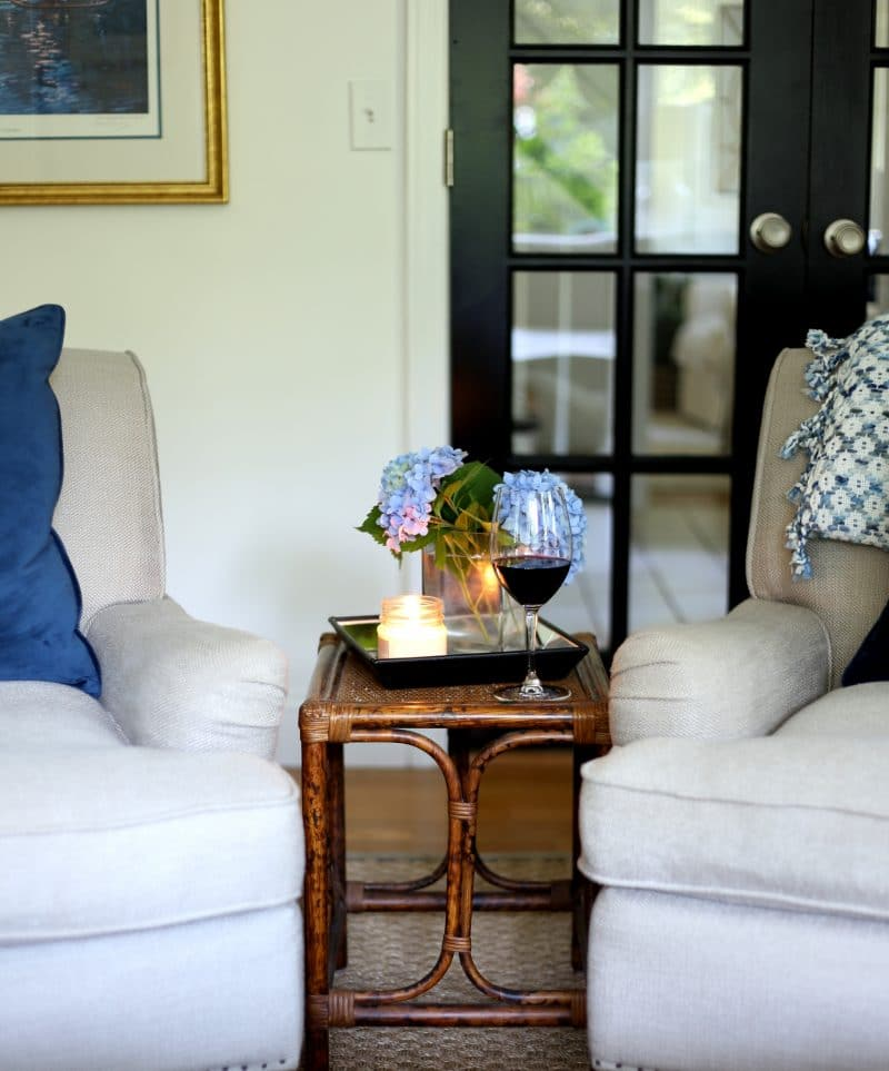 Small vintage rattan side table compliments new chairs.
