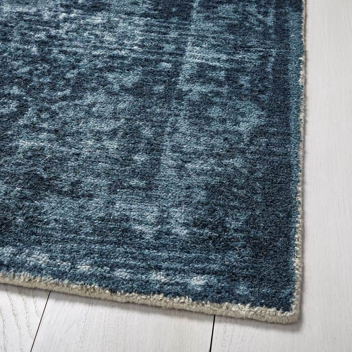 West Elm's distressed arabesque wool rug in midnight.
