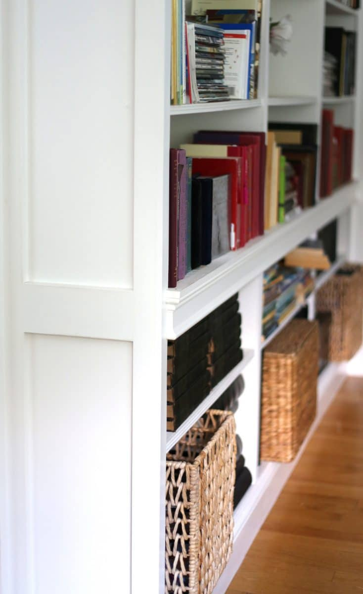 Use large baskets to give weight to a bookcase when styling.