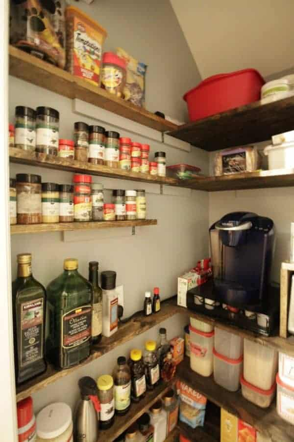 Narrow shelves in a pantry take advantage of every bit of space.