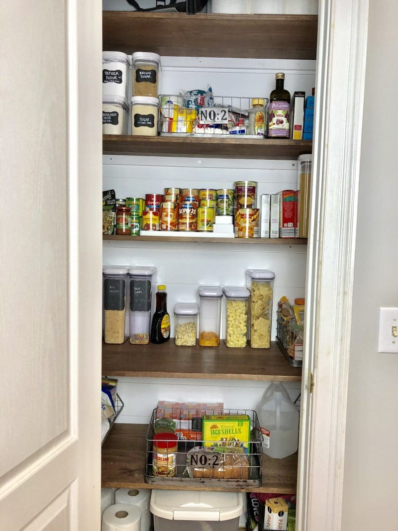 Pantry closet with wooden shelves