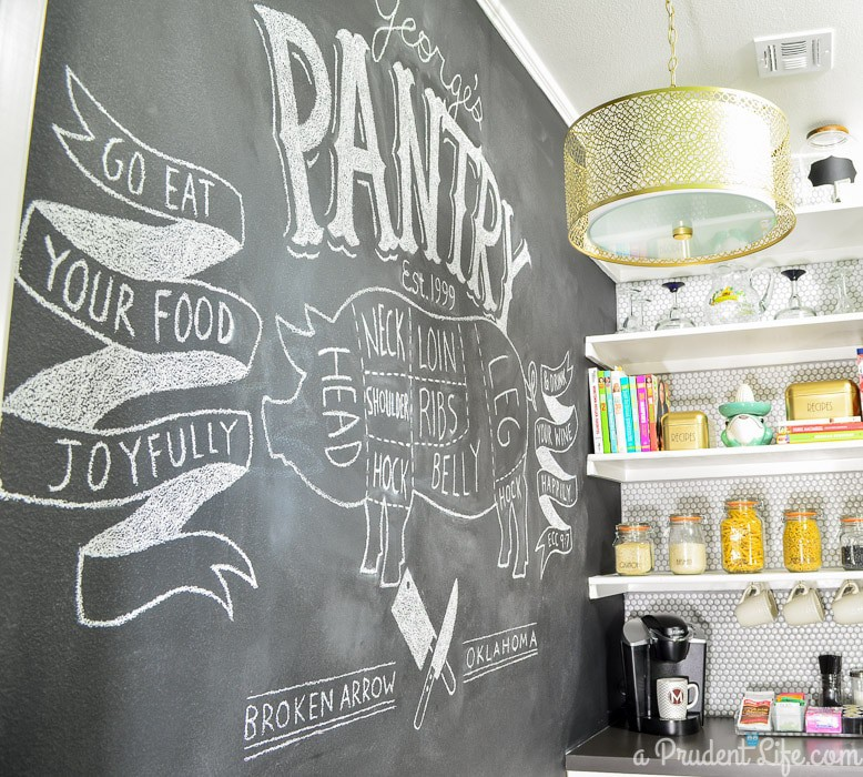 Chalkboard wall in a walk-in pantry.