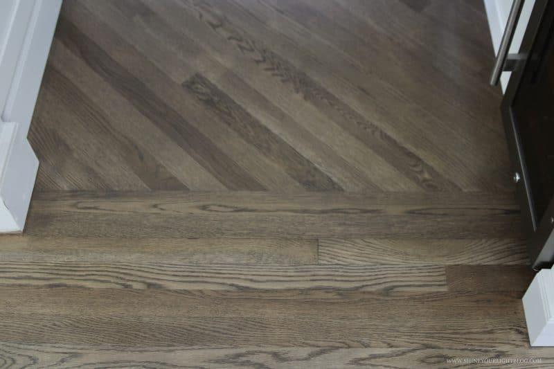 Transitioning hardwood floors between rooms