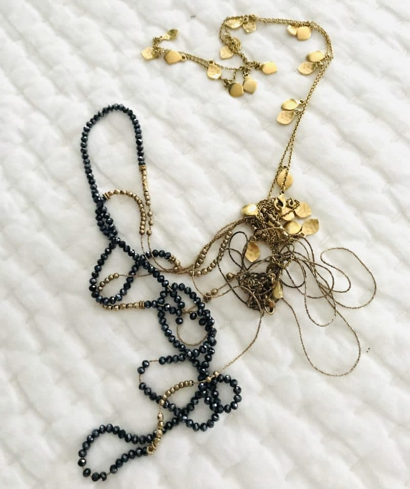 A tip for packing long necklaces for traveling that prevents them from tangling.