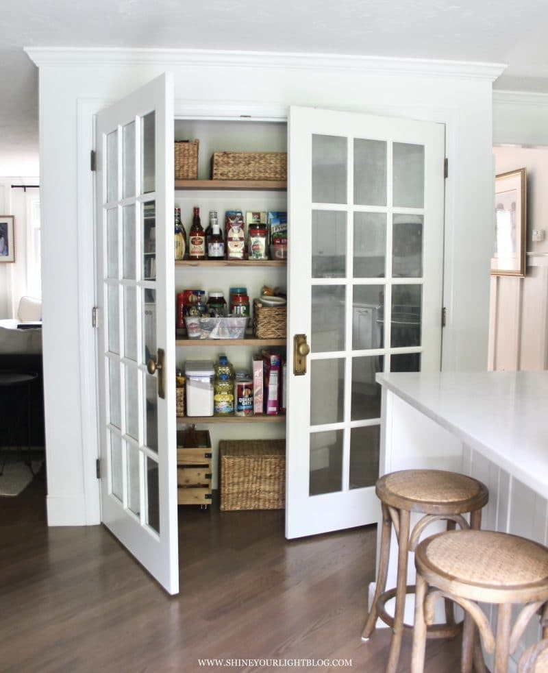 2x4 shelf risers in reach in pantry.