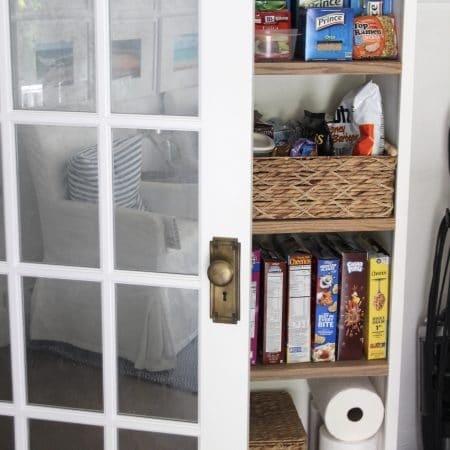 Reach-in pantry with 2x4 wood risers.