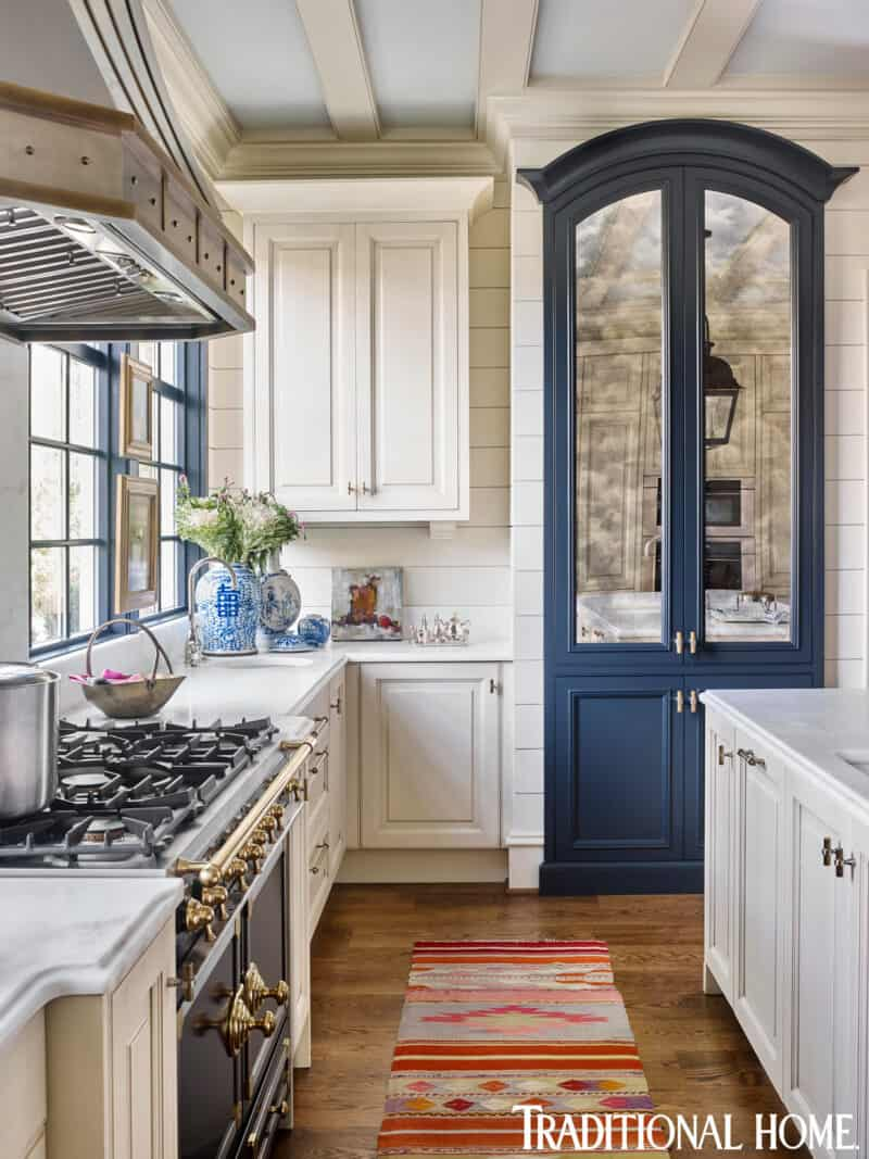 white and blue kitchen with mirrored pantry doors