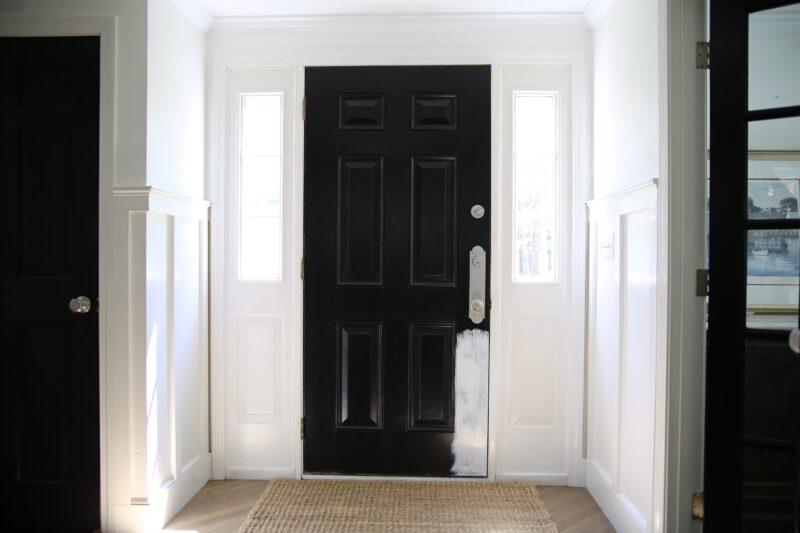 Black doors in white foyer
