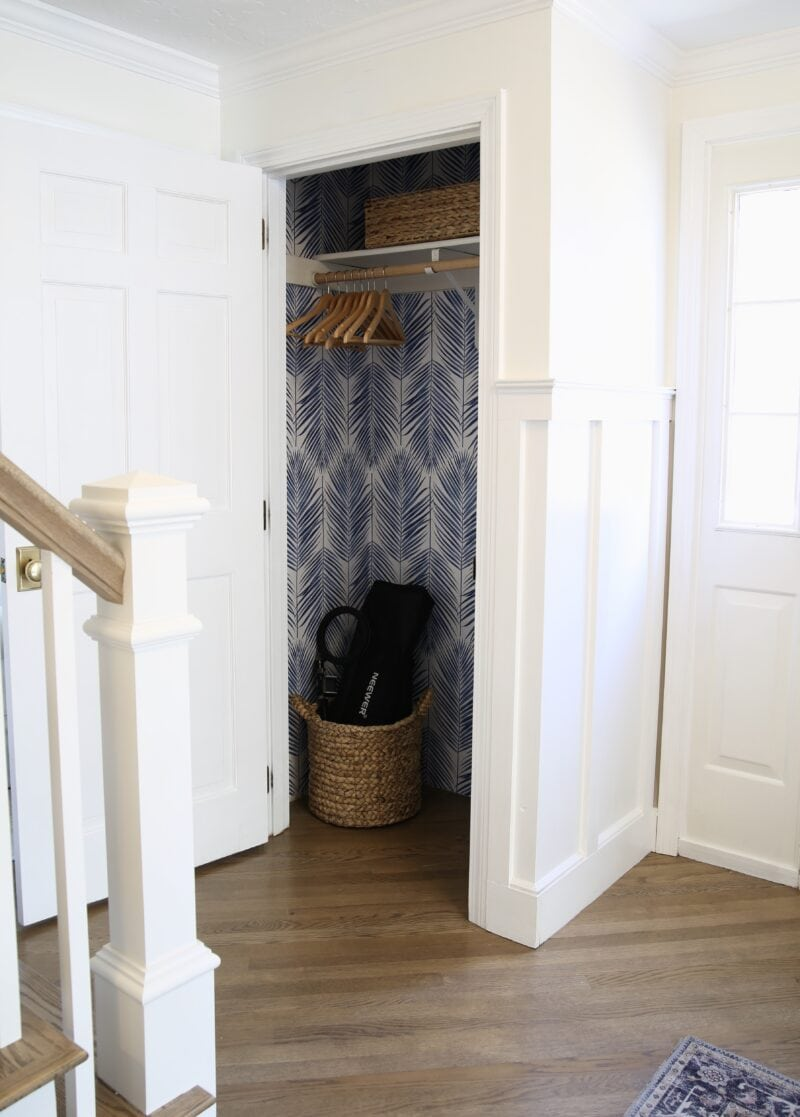 Reveal of coat closet makeover with blue and white peel and stick palm wallpaper
