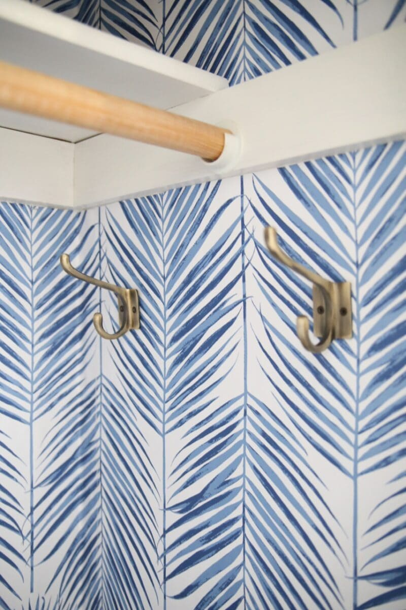 Blue and white peel and stick wallpaper in coat closet