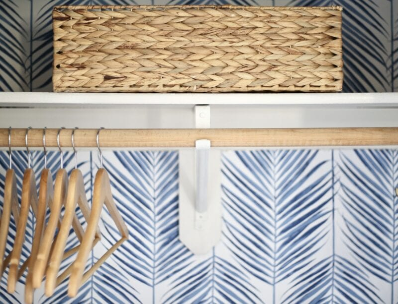 Coat closet reveal with peel and stick blue and white palm wallpaper
